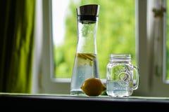 Shallow Focus Photography of Yellow Lemon Near Glass Mason Jar and Glass Decanter Stock Photos