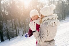 Free Shallow Focus Shot Of A Caucasian Mother Playing With Her Daughter On A Snowy Day Stock Photography - 194062682
