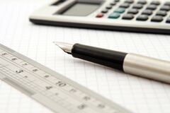 Shallow Focus of Silver and Black Fountain Pen Beside Ruler and Scientific Calculator Royalty Free Stock Image