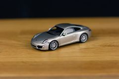 Shallow Focus of Silver Die-cast Model on Brown Wooden Board royalty free stock photography