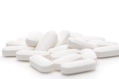 Shallow focus white pills on white Stock Photo