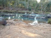 Shallow mountain stream in Odisha stock images