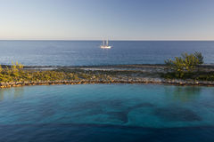 Shallow reef and sail ship, Paradise Island in Nassau, Bahamas Royalty Free Stock Photo
