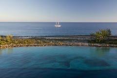 Shallow reef and sail ship, Paradise Island in Nassau, Bahamas Royalty Free Stock Photo