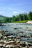 Shallow river. Flowing through the village called Rajcza on the southern Poland royalty free stock photos
