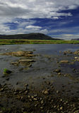 Shallow river. View of the mountians across a shallow riverbed Iceland Royalty Free Stock Photo