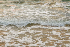 The shallow sea and small waves with foam on its tops Royalty Free Stock Photos