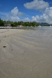 Shallow water area off Ile aux Cerfs Mauritius nearby the drop off point with many boats in the background Stock Images