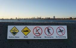Various Signs at St Kilda Beach Australia royalty free stock images