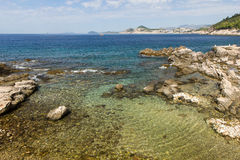 Shallow water and rocky coastline at Lokrum Island Stock Photo