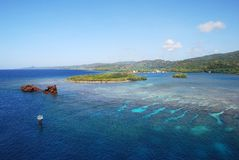 Shallow Waters. The view of Roatan island shallow waters with a sunken ship (Honduras Stock Photo