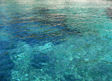 Shallow waters. Mediterranean sea water in a shallow bay stock photo