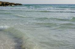 Shallow Waves Azure Water. At Ses Covetes, Mallorca, Balearic islands, Spain Stock Photography