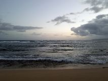 Shallow wavy ocean waters of Camp Mokuleia Beach. Looking into the pacific ocean with at dusk on Oahu stock image