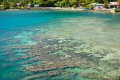 The Shallows. This is a photo of the clear water showing the coral formations and sandy bottom of a shallow water area close to the Port of Roatan on the Stock Images
