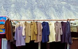 Shalwar Kamez hanging outside a tailor shop, Gilgit, Pakistan royalty free stock photos