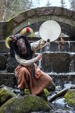 Shaman in the mask of the beast dances with a tambourine Royalty Free Stock Images