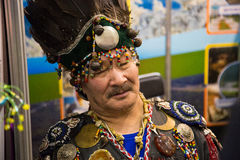 Shaman in national clothes tired and closed his eyes. Russia Royalty Free Stock Images
