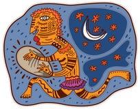 Shaman plays the tambourine. At night under the moon and stars Stock Photo