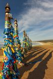 Shaman poles of serge on Olkhon in the sunset with long shadows Stock Images