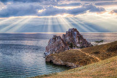 Shaman Rock, Lake Baikal in Russia. Shaman Rock - holy place for Buryats in Siberia, Lake Baikal, Russia Royalty Free Stock Images