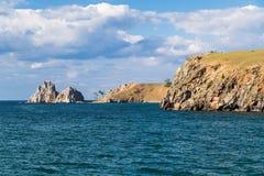 Shaman Rock, Lake Baikal in Russia. Shaman Rock - holy place for Buryats in Siberia, Lake Baikal, Russia Royalty Free Stock Photos