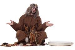 Shaman shrugs, isolated on white background. Image of shaman shrugs, isolated on white background Stock Photos