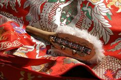 Shaman traditional accessory - wooden hammer with small bells fo Royalty Free Stock Images
