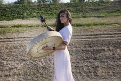 Shaman woman  drumming. Her drum Royalty Free Stock Images