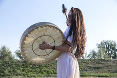 Shaman woman  drumming. By her self Royalty Free Stock Photography