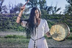 Shaman woman drumming. By her self Royalty Free Stock Photo
