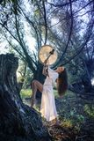 Shaman woman drumming. In the forest Royalty Free Stock Photography