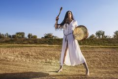 Shaman woman  drumming  2. Shaman woman  drumming  on the road Stock Images
