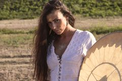 Shaman woman on the road drumming Royalty Free Stock Photography