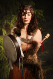 Shaman woman with a tambourine in the forest Stock Photography