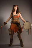 Shaman woman with a tambourine in studio Royalty Free Stock Photo