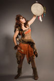 Shaman woman with a tambourine in studio Royalty Free Stock Photography