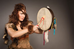 Shaman woman with a tambourine in studio Royalty Free Stock Images