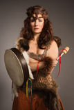 Shaman woman with a tambourine in studio Stock Photos