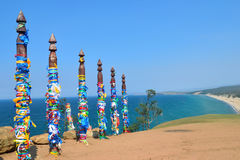 Shamanic pillars with colored ribbons Royalty Free Stock Photo