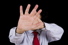 Shame. Man isolated on black hiding his head with the hands Royalty Free Stock Images