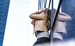 Shame, failure, making mistakes and embarrassment concept. Depressed and hysterical woman crying in city. Embarrassed person covering face with hands stock photo