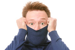 Shame. D man shyly pulling his turtle neck sweater over his face - isolated on white background Stock Image
