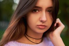 Shame and shyness facial expression. Shy girl Royalty Free Stock Photos