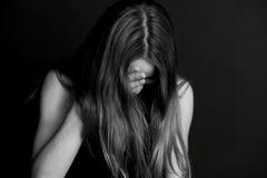 Shame, shyness or . Girl hiding face with hair. Shame, shyness or confusion. Girl hiding face with hair Stock Photos