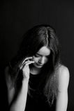 Shame, shyness or . Girl hiding face with hair. Shame, shyness or confusion. Girl hiding face with hair Stock Photography