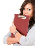 Shame student girl. Covering face clipboard looking at camera, white background Royalty Free Stock Photo
