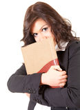 Shame young businesswoman with book Royalty Free Stock Image
