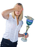 Shamed woman with trophy full of money Royalty Free Stock Image
