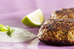 Shami kebabs. Lamb shami kebabs served on lilac plate with yogurt and mint sauce Stock Photography